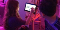 Around the room artists painted on the Windows 8 laptops and tablets.