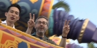 Epic Mickey designers Warren Spector and Peter Ong ride an inspiration for their upcoming games, Aladdin's Magic Carpet Ride at Disney World.